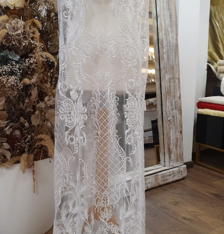 Ivory embroidery on tulle fabric. Photo 5