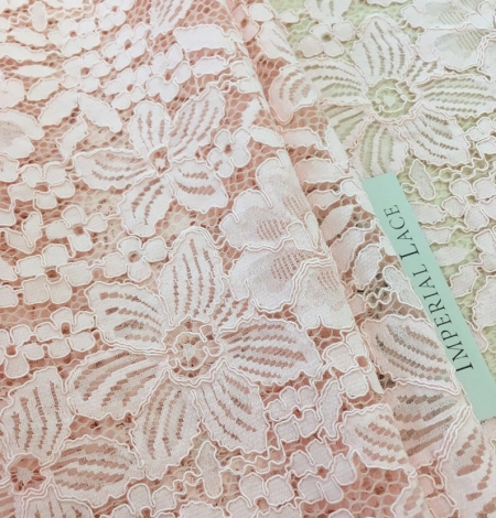 Salmon pink floral guipure lace fabric. Photo 3