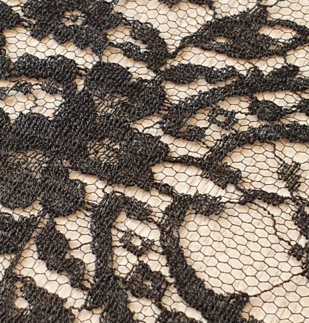 Black viscose chantilly lace fabric. Photo 6