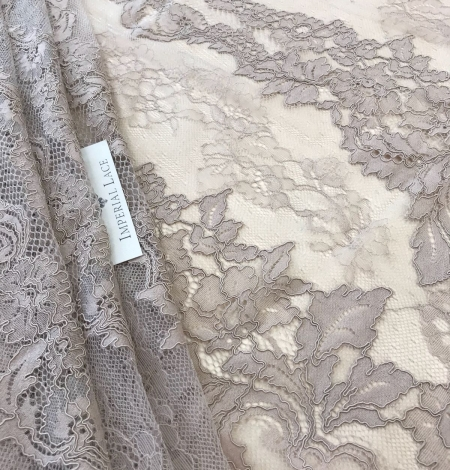 Dark ecru lace fabric. Photo 1