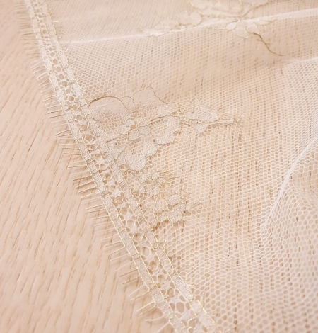 Ivory and grey with gold thread chantilly lace fabric. Photo 3