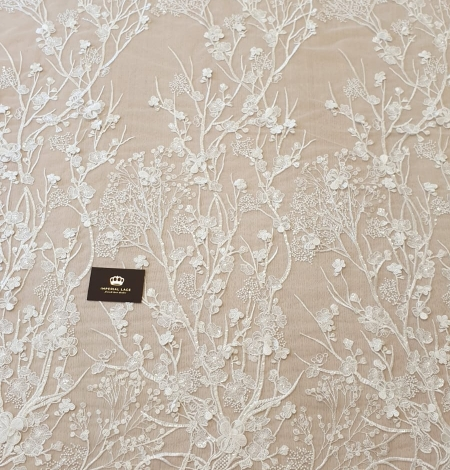 Ivory floral embroidery on tulle fabric. Photo 8