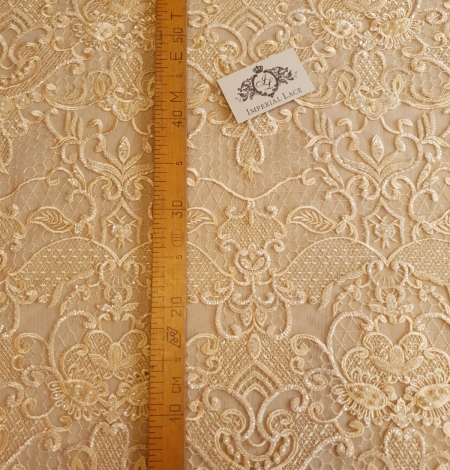 Yellow beaded lace fabric. Photo 6
