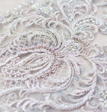 Beige embroidery on tulle fabric. Photo 2
