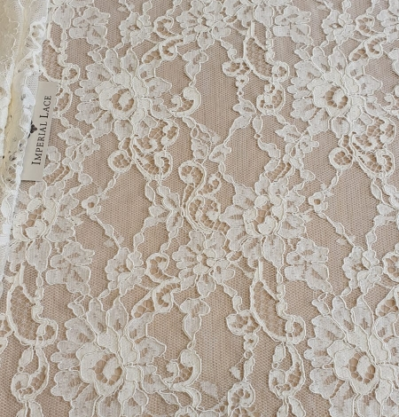 Champagne guipure lace fabric. Photo 2