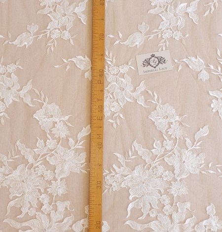 Ivory beaded floral pattern embroidery on tulle fabric. Photo 6