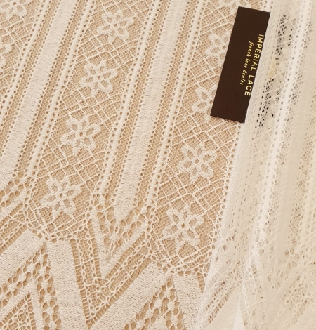 Ivory 100% polyester stripes and flowers guipure lace fabric. Photo 1