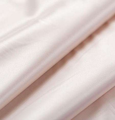 Pearl pink polyester satin with elastane fabric . Photo 4