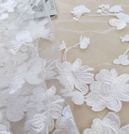 Bridal lace fabric with 3D flowers. Photo 1