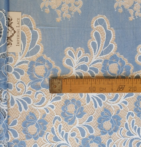 Light blue with white flower pattern fabric. Photo 6