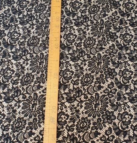 Black viscose chantilly lace fabric. Photo 5