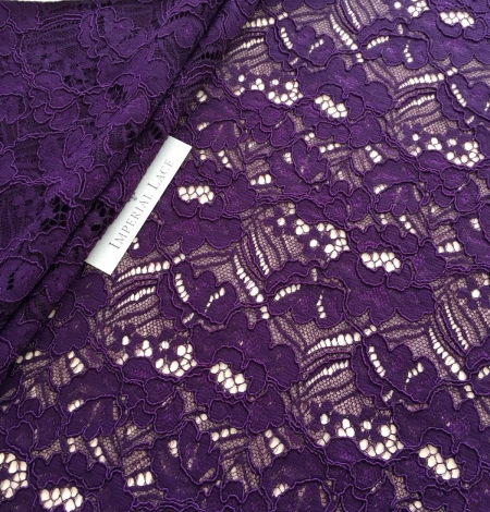 Violet guipure lace fabric. Photo 1