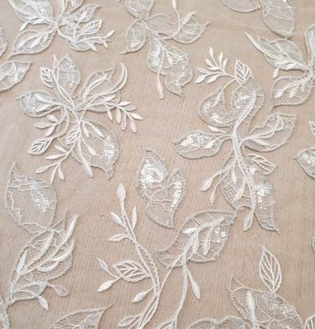 Ivory with silver thread embroidery on tulle lace fabric. Photo 2