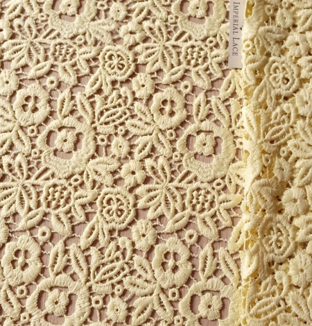 Yellow macrame lace fabric. Photo 1