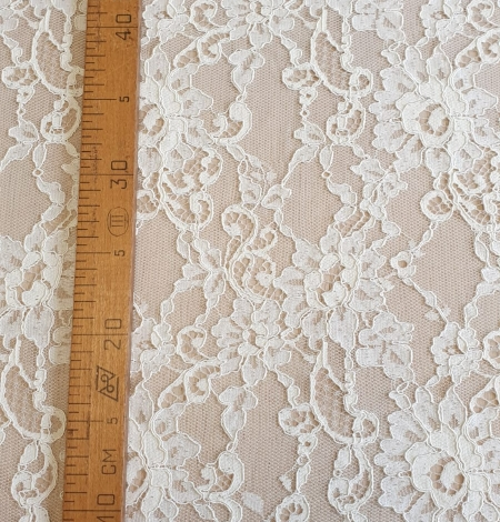 Champagne guipure lace fabric. Photo 6
