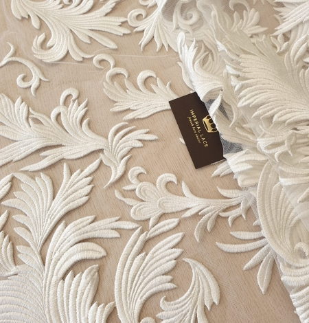 ivory thick embroidery on tulle fabric. Photo 1