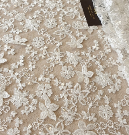 Ivory floral growing embroidery on tulle lace fabric. Photo 2