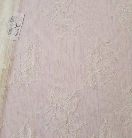 Light yellow lace fabric. Photo 7