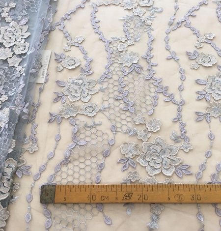 Greyish blue embroidery on tulle fabric. Photo 9