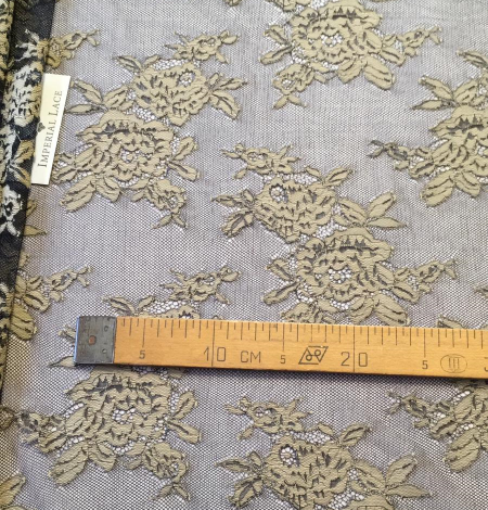 Black with beige flowers lace fabric. Photo 8