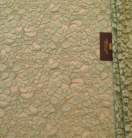Light apple green guipure lace fabric. Photo 2