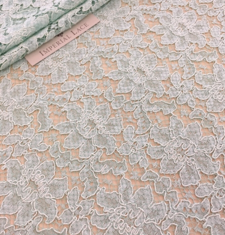 Mint green lace fabric. Photo 7