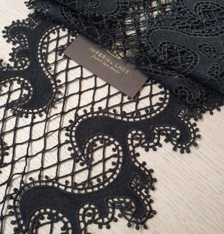 Black 100% polyester wave effect guipure lace trimming. Photo 1