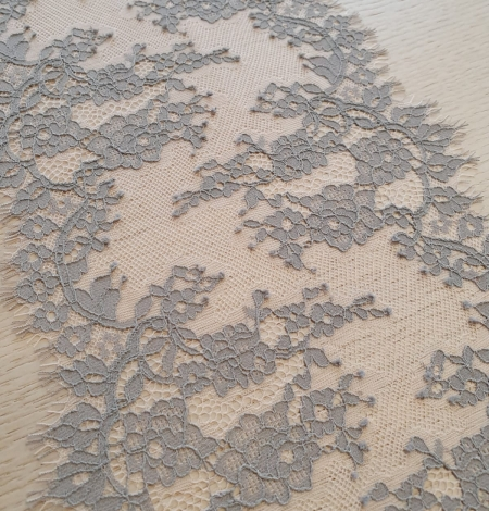 Light grey on peach tulle floral lace trimming. Photo 3
