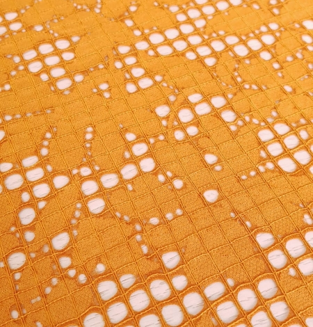 Rust tone color chantilly lace fabric. Photo 3