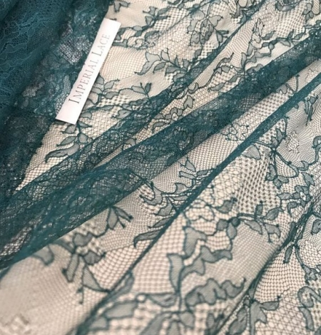 Deep teal green lace fabric. Photo 2