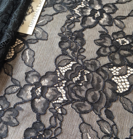 Black floral pattern lace fabric . Photo 2