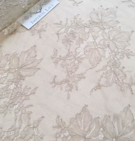 Beige lace fabric. Photo 6