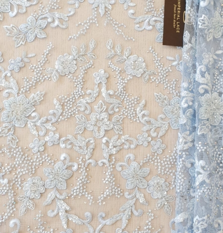 Light blue beaded embroidery on tulle fabric. Photo 5