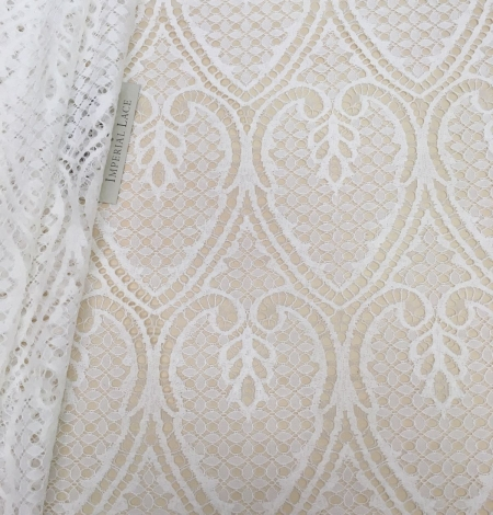 Ivory figurative lace fabric . Photo 1