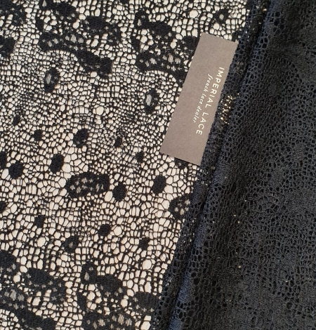 Black interesting design viscose guipure lace fabric . Photo 1