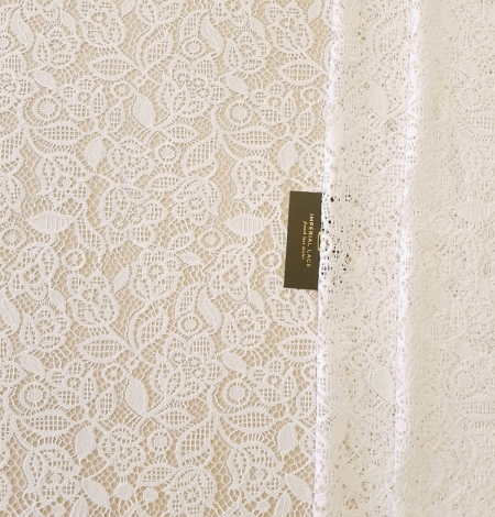 Snow white guipure floral pattern lace fabric. Photo 8