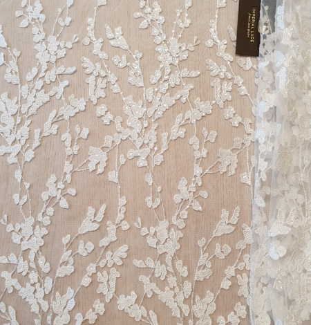 Ivory embroidery on tulle lace fabric. Photo 2