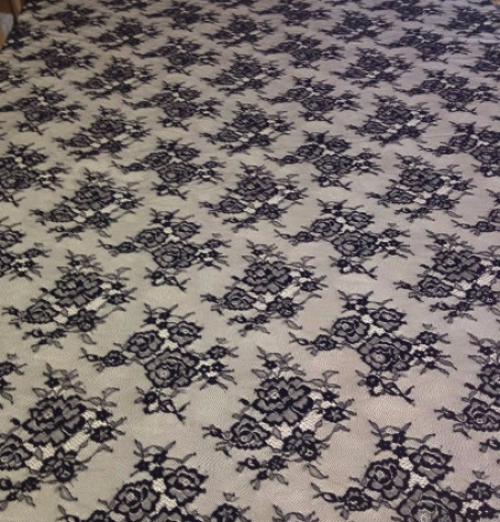 Lace fabric black color. Photo 1