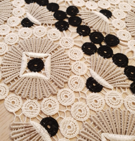 Beige with black and white macrame lace fabric. Photo 4