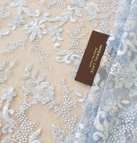 Light blue beaded embroidery on tulle fabric. Photo 1