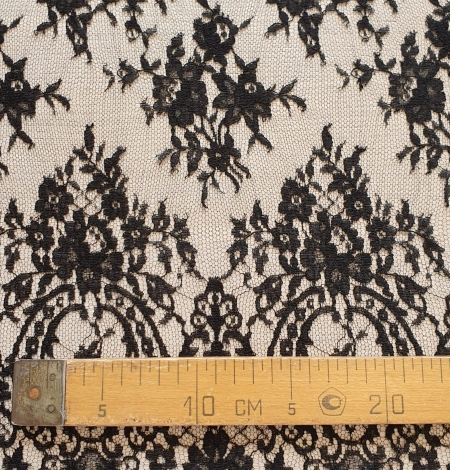Black viscose chantilly lace fabric. Photo 8