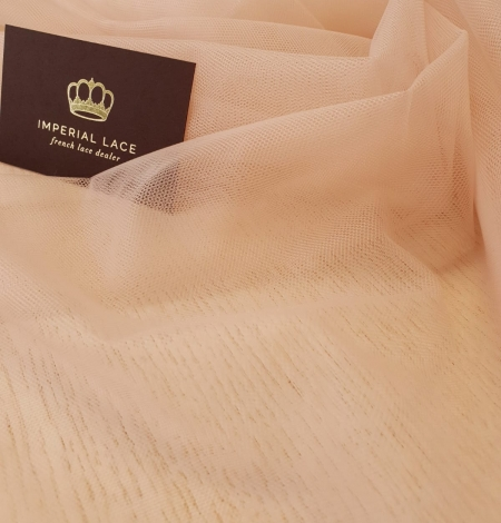 Nude 100% polyamide clear invisible tulle fabric. Photo 2