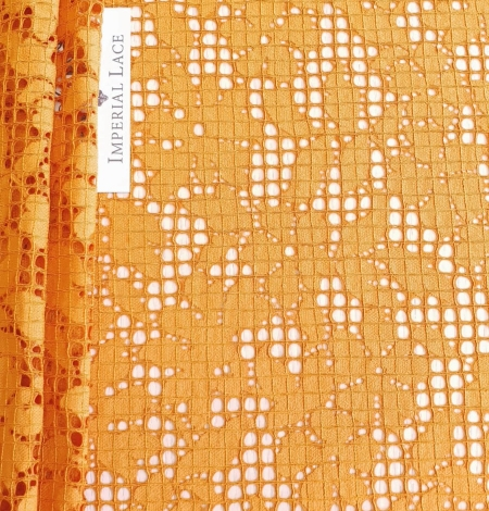 Rust tone color chantilly lace fabric. Photo 1