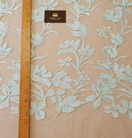 Blue floral pattern sequin embroidery on tulle fabric. Photo 9