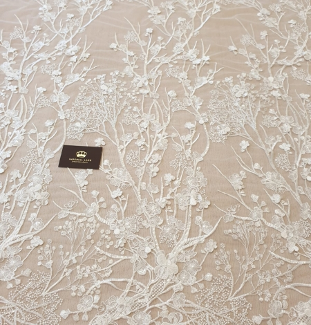 Ivory floral embroidery on tulle fabric. Photo 7