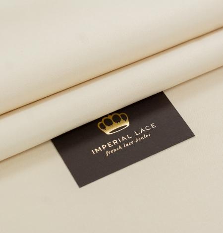 Cream color silk duchess fabric . Photo 1