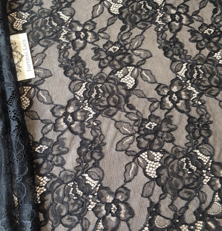 Black floral pattern lace fabric . Photo 1