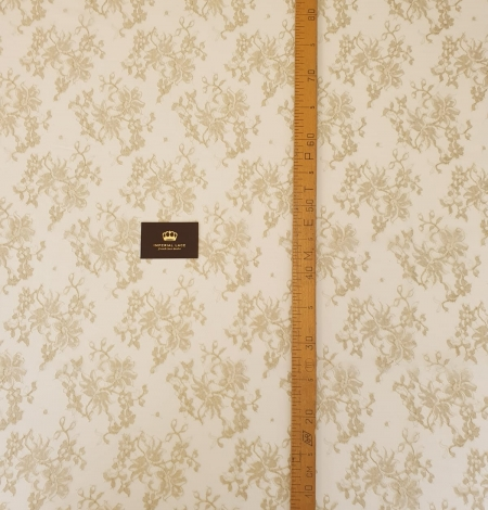 Ivory with gold thread viscose lace fabric. Photo 4