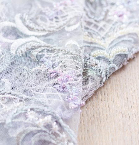 Greenish with purple embroidery on tulle fabric . Photo 4