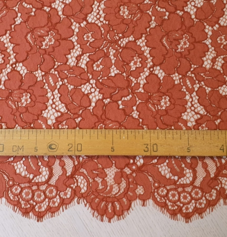 Redish brown guipure lace fabric. Photo 6